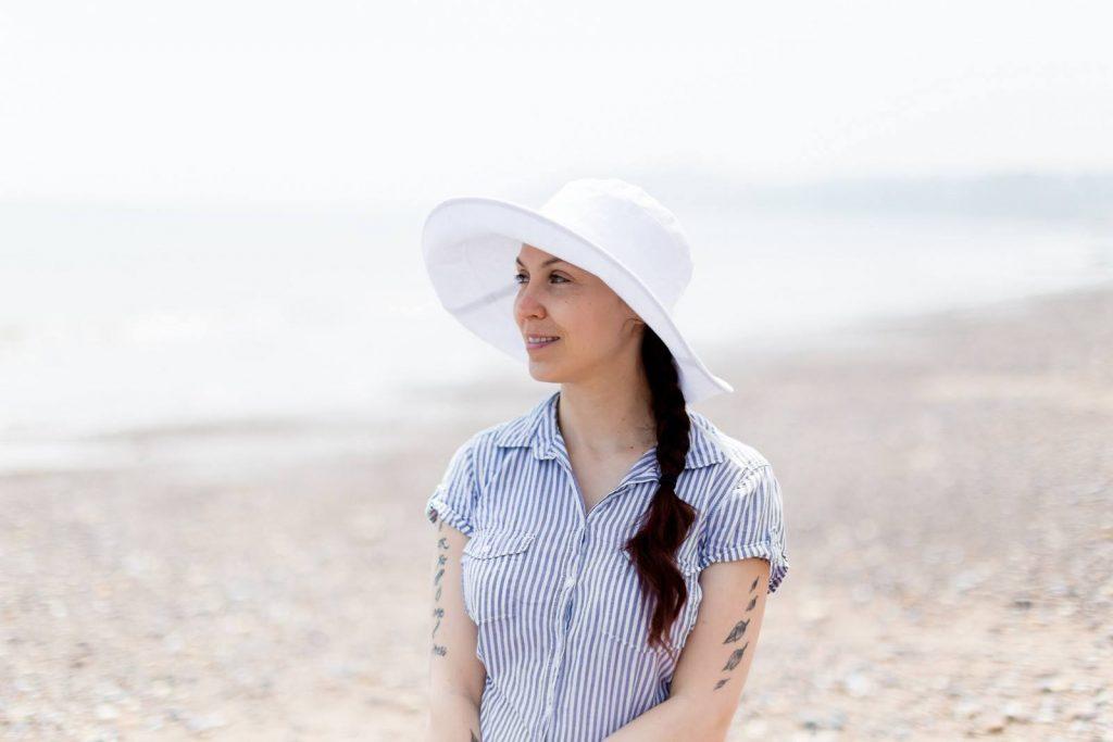 Wear a hat when you're out in the sun, and you'll reduce premature aging and dark spots
